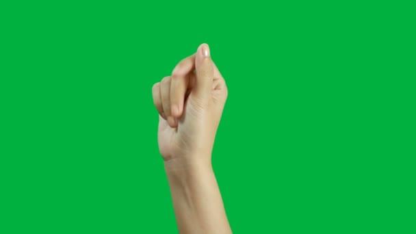 4k. close-up žena ruka lusknout prst nebo klikne rukou izolované na zelené obrazovce chroma klávesy