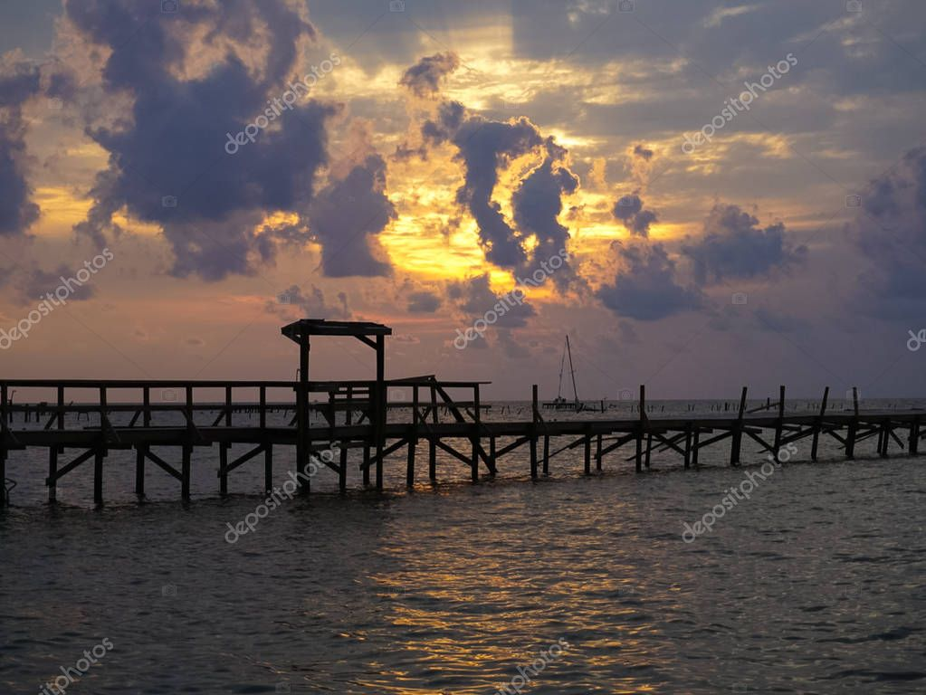 A Sunrise over the Bay with pier destruction in Rockport Texas after the hurricane