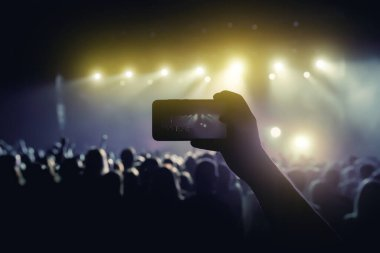 Social media photo to mobile phone. Concert light performance