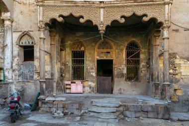 Facade of Bayt Madkour Pasha historic abandoned house, Souq Al Selah Street, Old Cairo, Egypt