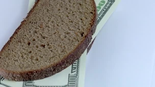 sandwich made of bread and dollars on white background close-up