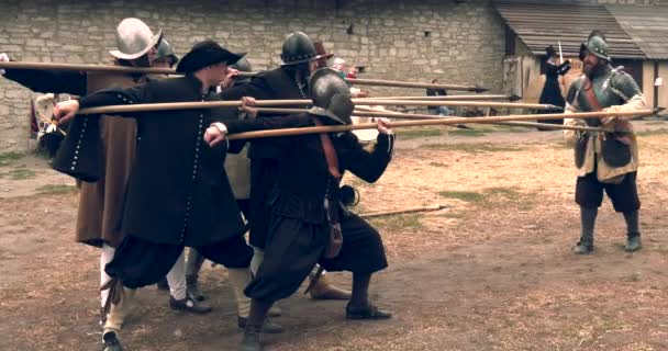 KAMYANETS-PODILSKY, UKRAINE - 21 SEPTEMBER , 2019: Historical military reconstruction of the Ukrainian and Polish troops of the seventeenth century in the castle of Kamyanets-Podilsky.