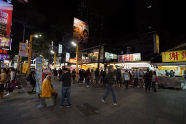 Taipei, Taiwan - November 23, 2018 : Ximending Night Market and street food in Taipei, Taiwan. This district crowded walking and shopping tourists.