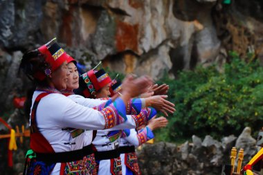 People with traditional costumes in the Stone Forest in Yunnan, China