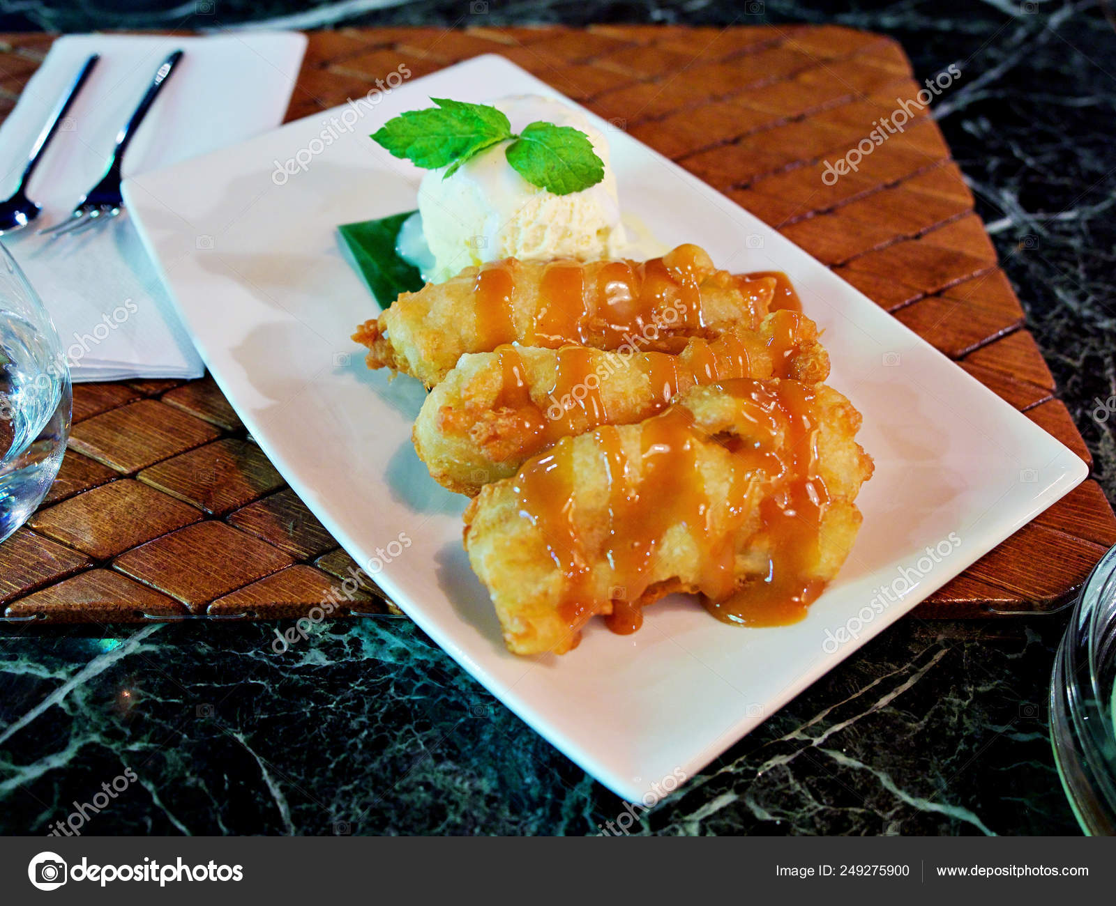 Thai Style Deep Fried Crispy Banana Fritter With Vanilla Ice Cream And Caramel Syrup Sauce Served On Green Fresh Banana Leave Stock Photo Image By C Digitalmammoth 249275900