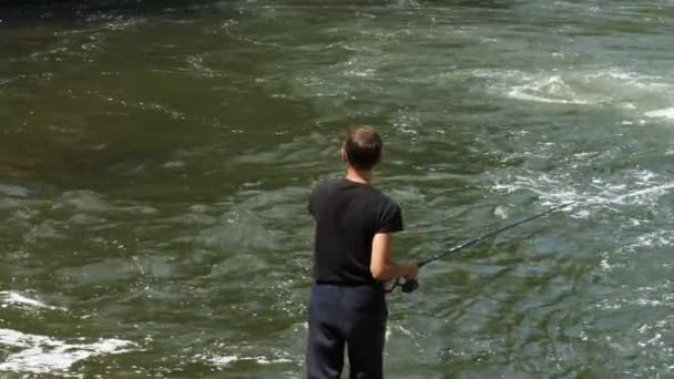 Man is fishing by the river