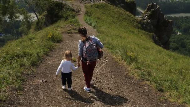 Woman and little girl on vacation. Beautiful landscape.
