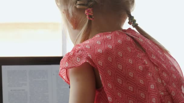 Little cute girl using laptop