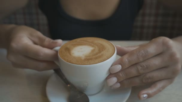 Closeup of female mouth tasting coffee