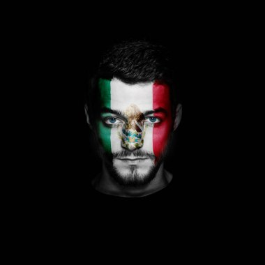 Flag of Mexico painted on a face of a man.
