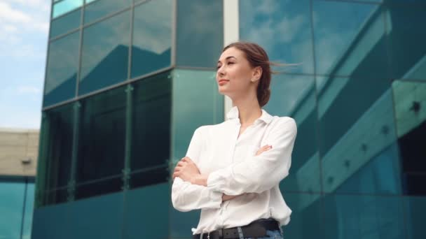 Businesswoman successful woman business person standing outdoor corporate building exterior. Pensive caucasian confidence professional business woman middle age