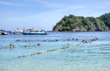 Trengganu, Malaysia. June 24, 2019 : Scenic view and activity of the tourist enjoying the snorkeling beach site at Marine Park, Redang Island.
