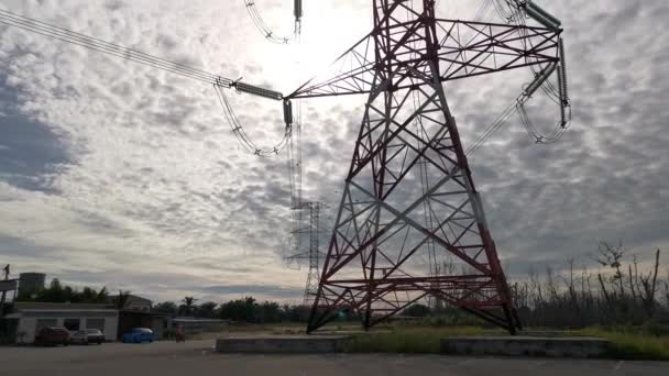 footage of looking up the tall electric supply tower