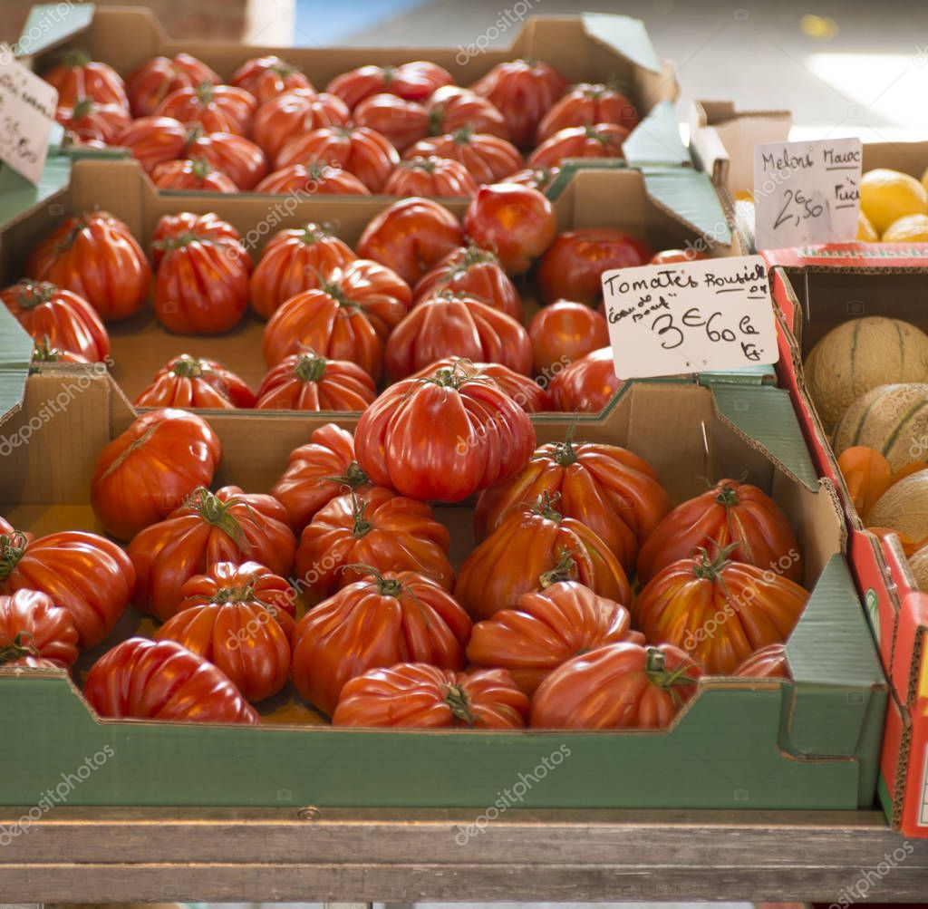 Box of big red tomatoes known as Beef tomatoto or Beefsteak tomato, ready for sale.