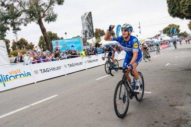 Amgen Tour of California 2019. Cyclists Cross Finish Line in Morro Bay. Morro Bay, California, USA, May 15, 2019