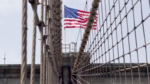 New York City. Brooklyn Bridge, American Flag. Bridge  Connects the Boroughs of Manhattan and Brooklyn, Spanning the East River.