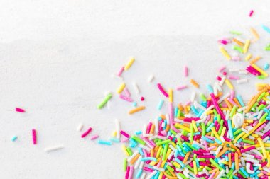 Sugar sprinkles on white background as decoration for cake and bakery.