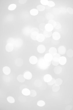 Elegant Abstract Silver Christmas Background with white bokeh lights for Holiday Poster, Banner, Ad, Card or invitation