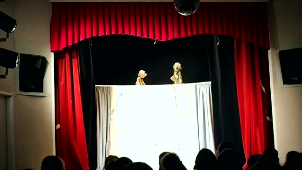 Children's puppet theater. Presentation in the children's theater, organized for children and their parents. Details and close-up.