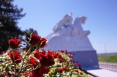 Monument with roses. Field of the Cossack glory.