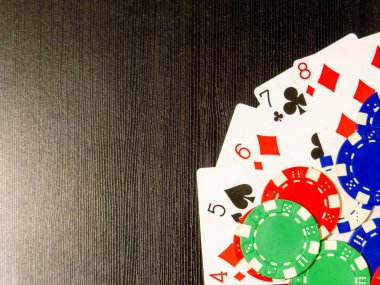 Poker Cards in straight flush and poker chips