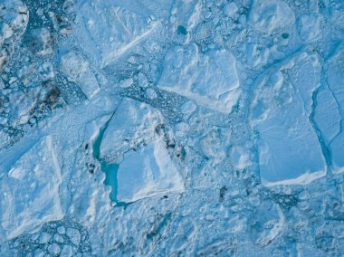 Icebergs drone aerial image top view - Climate Change and Global Warming. Icebergs from melting glacier in icefjord in Ilulissat, Greenland. Arctic nature ice landscape in Unesco World Heritage Site stock vector