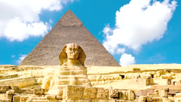 Timelapse of the famous Sphinx with great pyramids in Giza valley, Cairo, Egypt