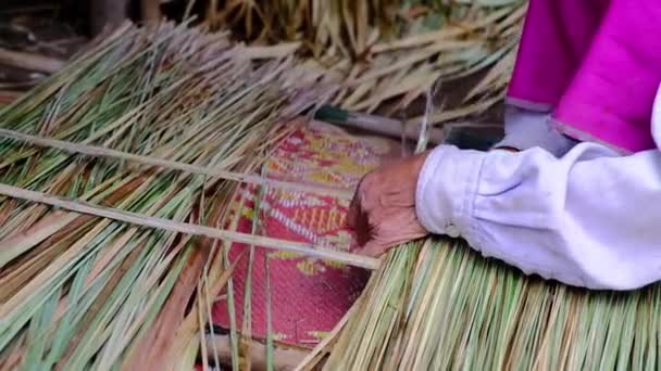 Part of hand making traditional roofing in north Thailand. making traditional roofing in a village in north Thailand.