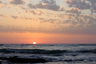 sunset and sky and sea and clouds in the Mediterranean Sea in Israel