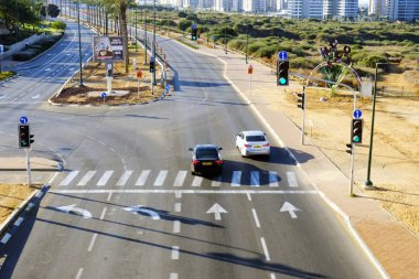 ISRAEL - Netanya, 12 October 2017: city intersection with traffic lights and road markings and cars