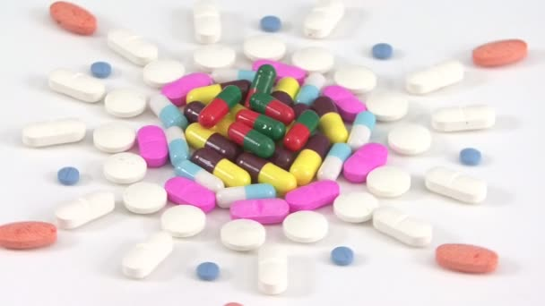 Pills medicine rotating in white background