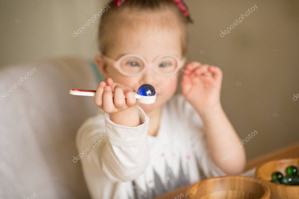 a girl with Down syndrome are trained at Montessori