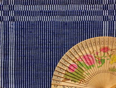 vintage Chinese wood fan on table cloth