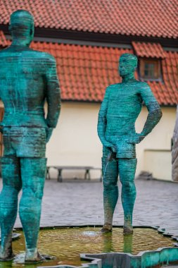 Famous Fountain of the pissing man in Prague - Two men pissing into a puddle - Sculptor David Cerny