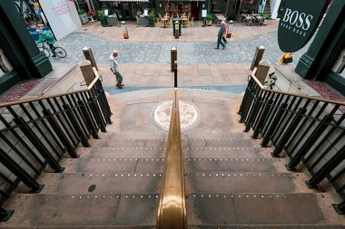 CHESTER, UK - 26TH JUNE 2019: The stairs of the Grosvenor shopping centre in the middle of Chester, Chestershire, UK