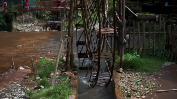 Famous Cat Cat Waterwheels in Northern Vietnam spinning in the river on a hot day in Autumn
