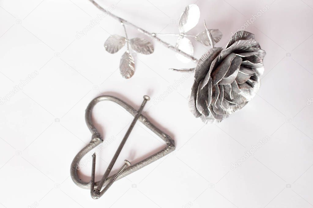 Hand forged rose. Rose handmade forged from metal on a white background.