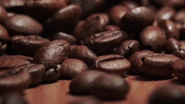 Extreme close-up of roasted coffee beans. Animation video of falling coffee beans in slow motion.