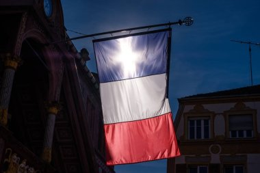 Sun cross in a French Tricolore in Mulhouse city