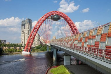 View of the picturesque red bridge serez Moscow river and modern architectural structures on a clear summer day