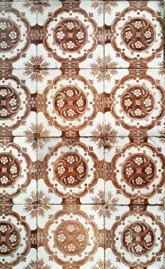 Mosaic tiles, Portugal Azulejo Classic and Traditional. Brown Patterned wall, medieval ceramics tiles, heritage. Painted panel with a round geometric pattern. Mauritanian Wallpeper