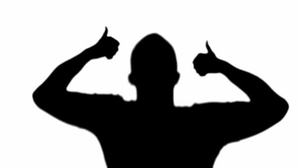 Front view of silhouette of happy man showing thumbs up and dancing isolated on white