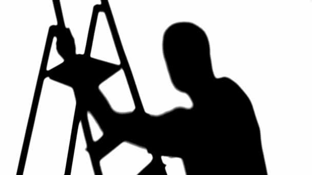 silhouette of man looking up and rising on step ladder isolated on white