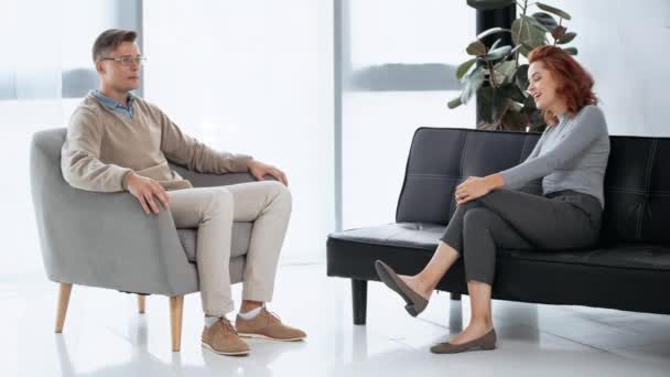 patient sitting and talking with psychologist
