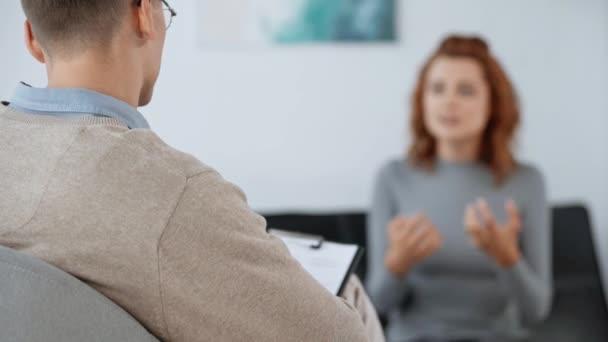 selective focus of psychologist listening to patient