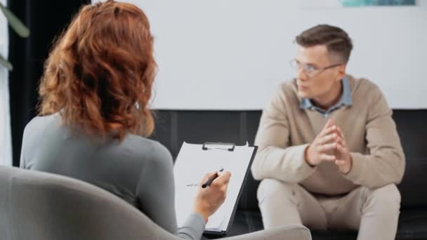 selective focus of psychologist talking with patient