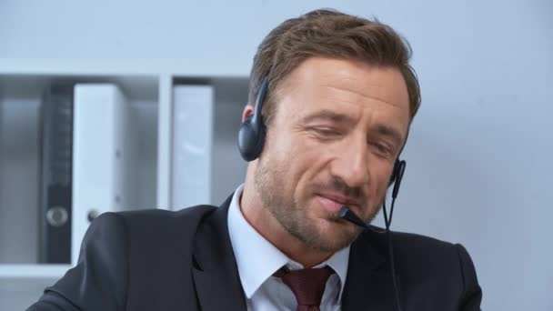 call center operator talking in headset in office