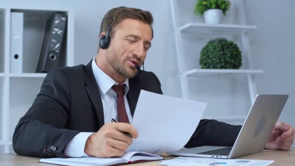call center operator in headset working in office