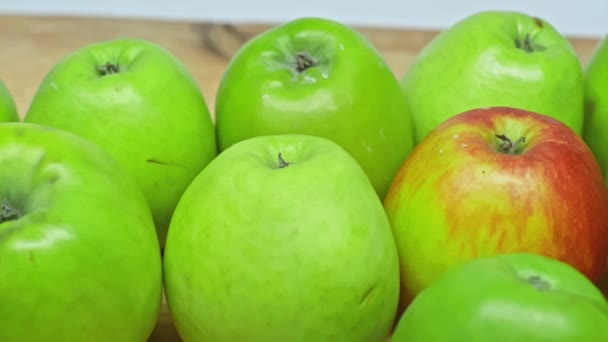 Close up view of fresh apples on wooden surface