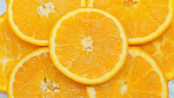 Top view of spinning slices of fresh orange